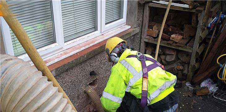 Wall having defective insulation material removed